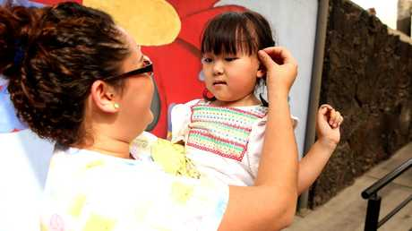 Annabelle Nguyen with one of the nurses at the Clinica 0-19 in Monterrey Mexico. Picture: Nathan Edwards