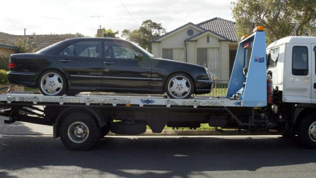 The 2000 Mercedes Benz being towed from outside the Parkdale home.