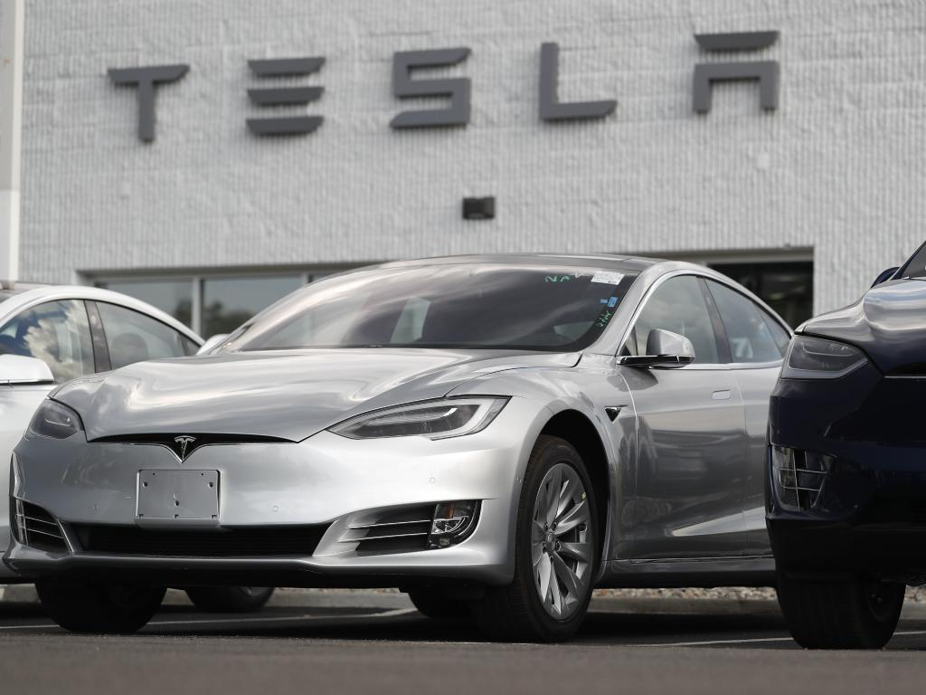 A2018 Model 3 sedan sits next to a Model X on display outside a Tesla showroom in Littleton, Colorado. Board members at Tesla are evaluating CEO and Chairman Elon Musk's $70 billion proposal to take the electric car and solar panel maker private. Picture: AP