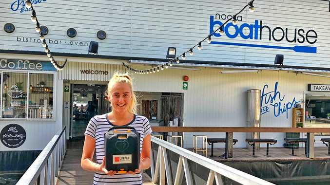 Renee with the defib that saved a man's life.