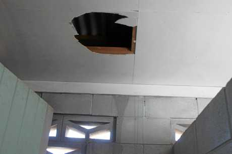 Holes were smashed in the bathroom ceiling and walls as they tried to get into the bar.