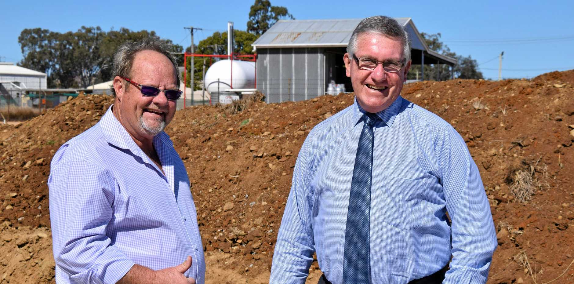 NEW DEVELOPMENTS: Cr Terry Fleischfresser and Mayor Keith Campbell on the site of the new Astill's Electrical building.
