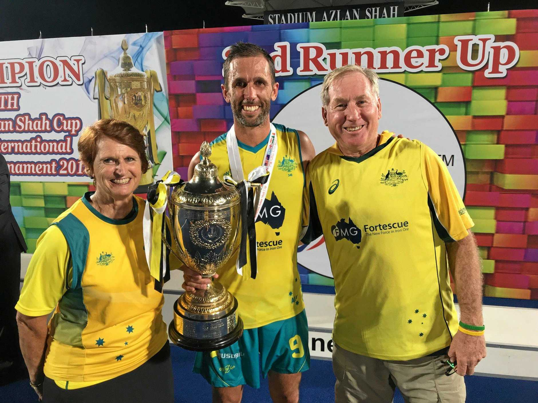 Captain Mark Knowles celebrates the Kookaburras win at the 2017 Azlan Shah Cup with parents Barb and Ryan Knowles.