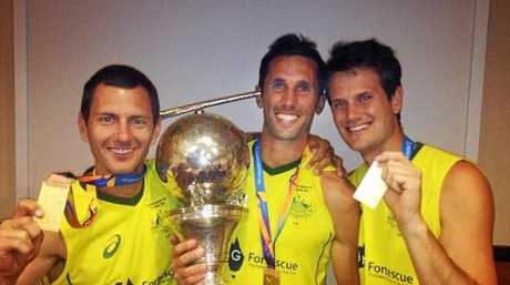 Jamie Dwyer, Mark Knowles and Matt Ghodes after the Kookaburras won the World Cup in 2014.
