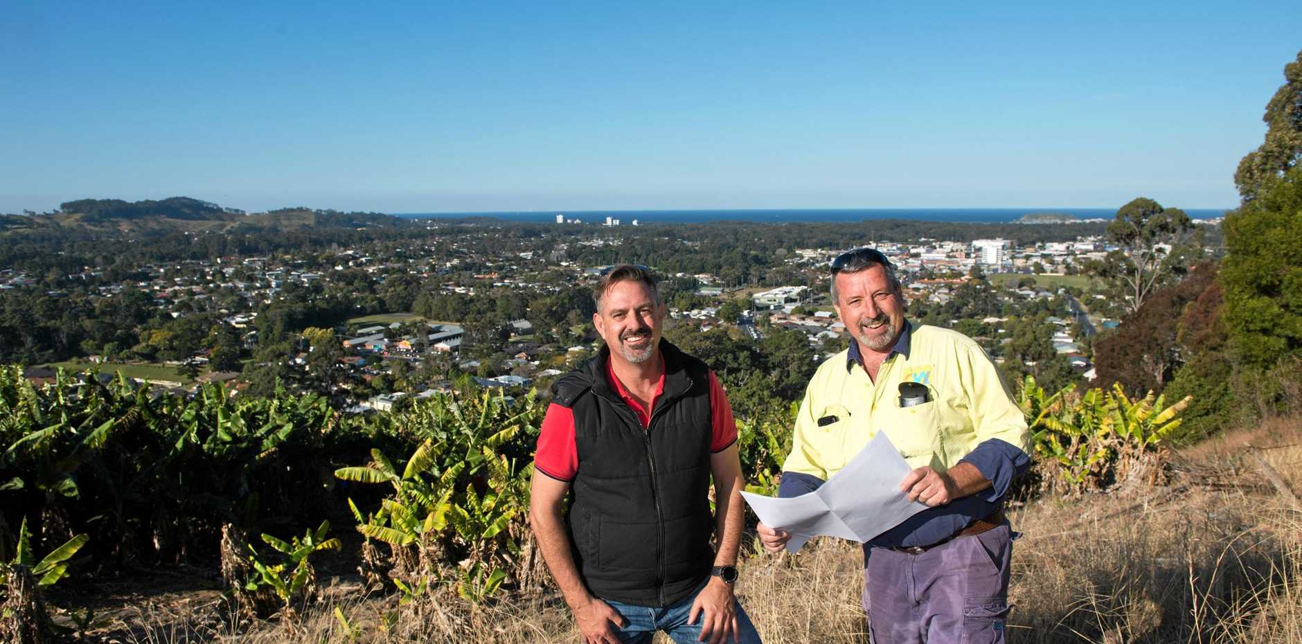 VIEW POINT: Coffs Harbour Chamber of Commerce committee member Callan Bailey gets a briefing on the Roberts Hill Lookout plan from Neil Manson.