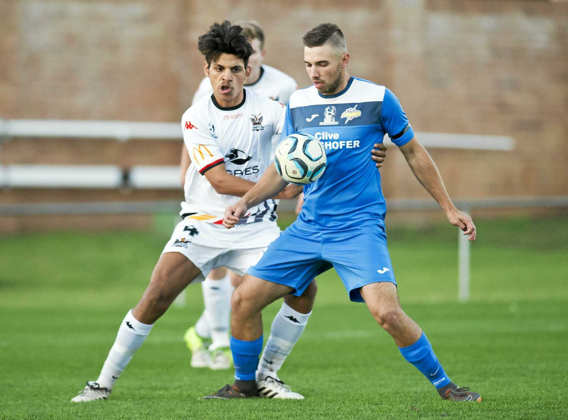 DOUBLE DELIGHT: South West Queensland Thunder striker Anthony Grant (right) scored a double in his side's 2-1 win over Moreton Bay United last weekend.