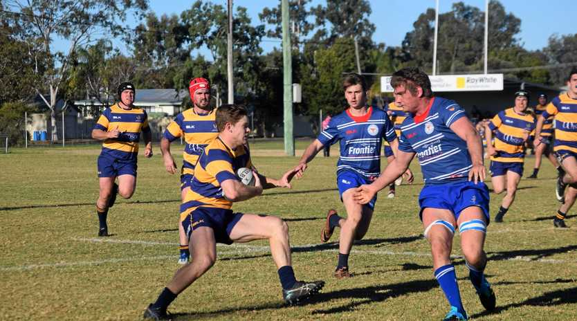 Dalby's Matt Donovan looks to beat the defence of Andre van Staden for USQ in their round-15 Risdon Cup match at John Ritter Oval.
