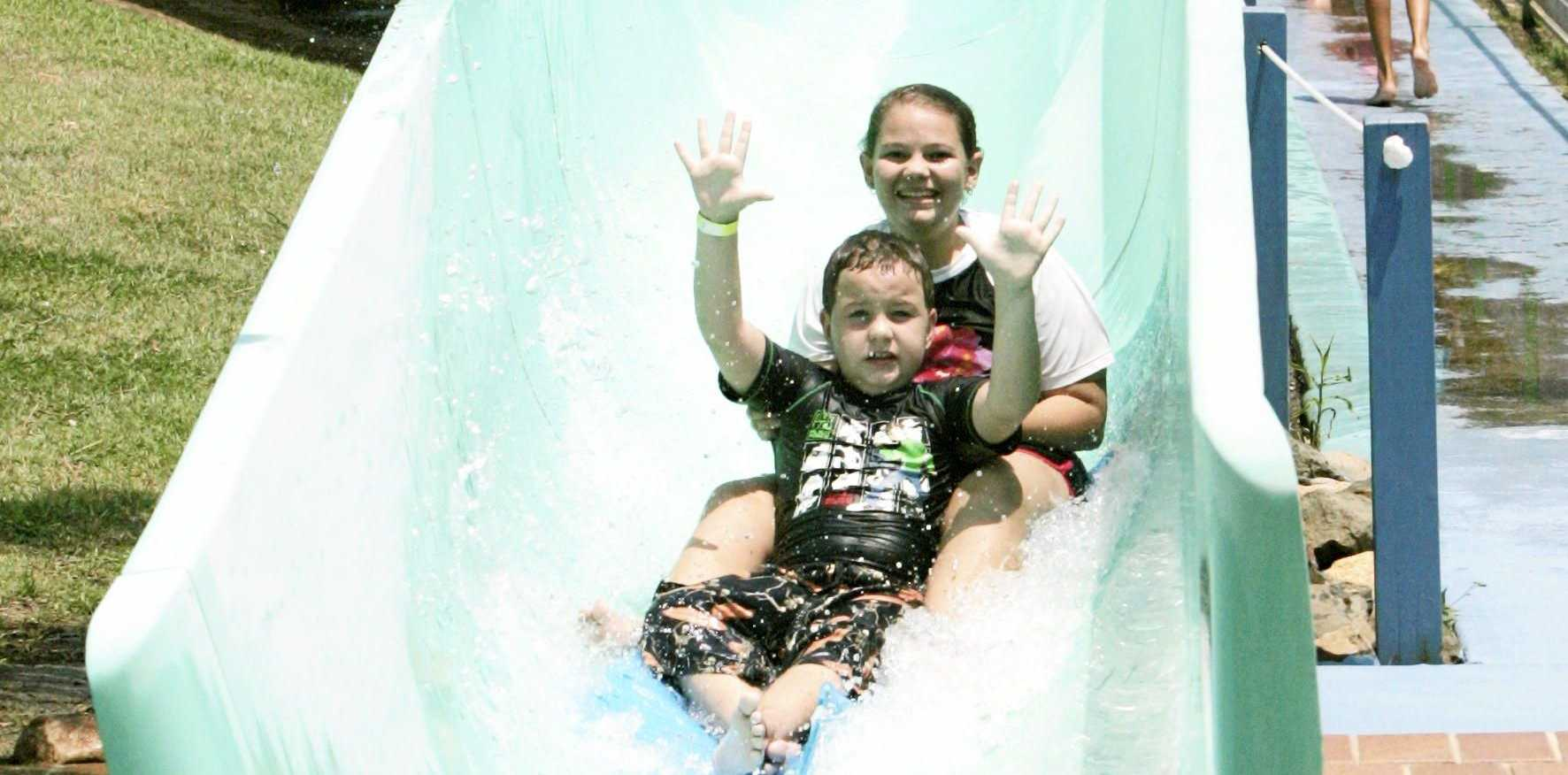 Hannah Ellis and Lachlan Charles slide down the slides at the former Rock Pool Water Park in Rockhampton in 2012. A new park will be coming to Rockhampton this December just in time for summer. Photo Sharyn O'Neill / The Morning Bulletin