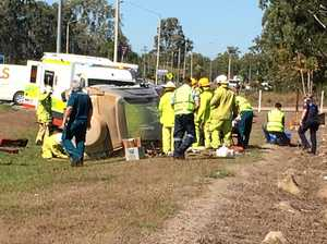 Woman hospitalised after being trapped in car roll-over