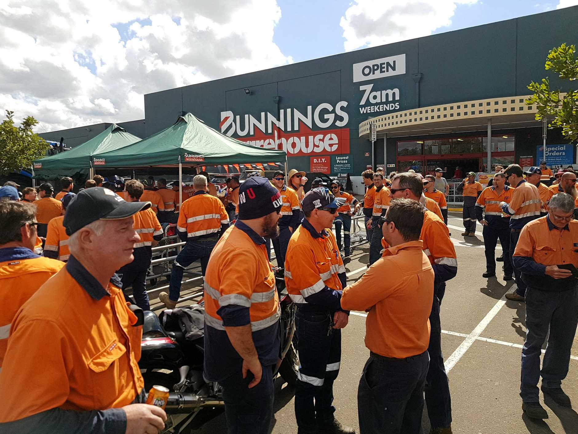 Workers at Downer EDI's Maryborough factory walked off the site on strike on Monday morning. The workers gathered in the Bunnings Warehouse car park and presented a cheque from their own money to the Farmers Drought Appeal.