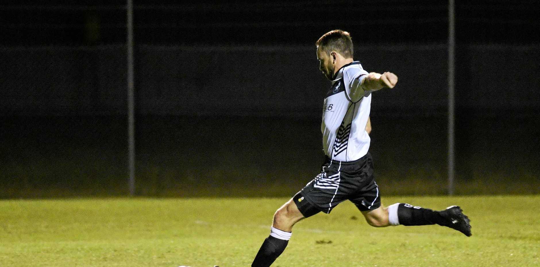 Doon Villa's Joel Neilsen takes a penalty. FFA Cup: Doon Villa v Sunshine Coast Fire at Villa Park, Maryborough.