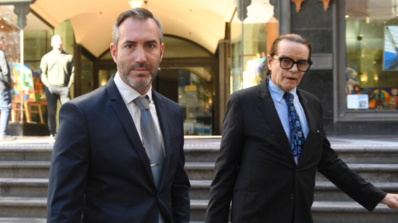 Liam Gordon Murphy (left) leaves the Downing Centre Courts with his barrister Charles Waterstreet on Friday.