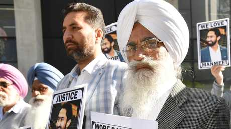 Manmeet Alisher's father Ramsaroop Sharma outside court in Brisbane today. Picture: Darren England/AAP