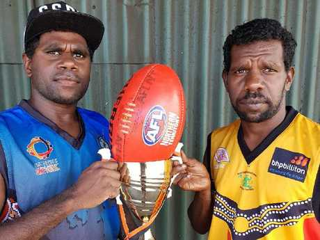 Players pose with the Groote Eylandt premiership trophy.