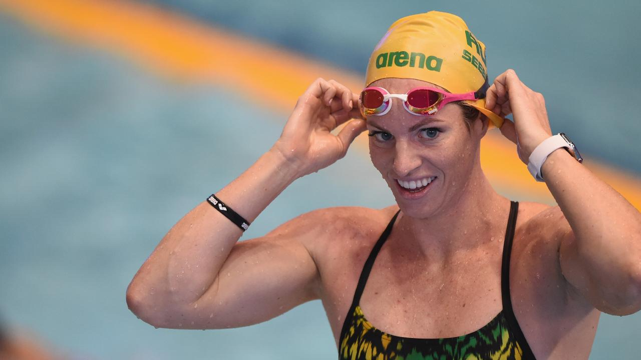 Emily Seebohm lowered the 100m backstroke record before it was broken again in subsequent heats. (AAP Image/Matt Roberts)