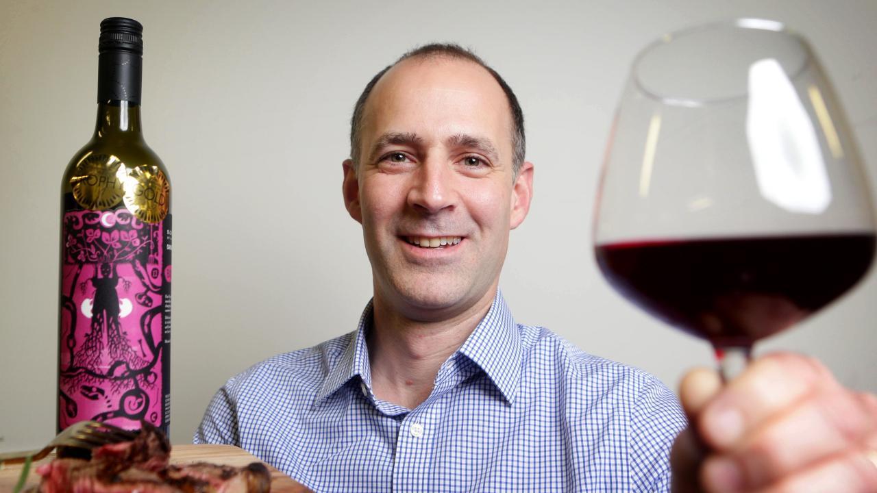 Brendan Christou tucks into the Ekka's award-winning wine and beef. Picture: AAP/Steve Pohlner
