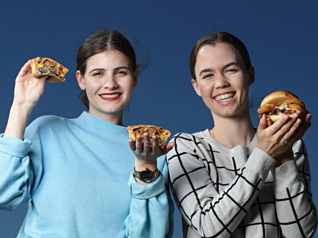 Julia Moreton and Alice Ringelstein show off some of this year's Ekka delicacies Picture: Annette Dew