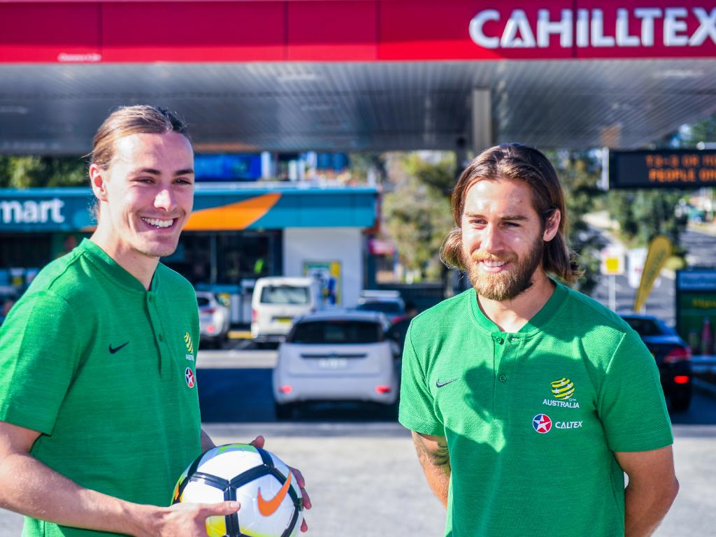 Socceroo Jackson Irvine (left) and Josh Brilliant pose for a photograph during an unveiling of a world-first tribute to Tim Cahill ahead of the Socceroo's World Cup campaign in Russia in Sydney, Tuesday, May 15, 2018. (AAP Image/Brendan Esposito) NO ARCHIVING