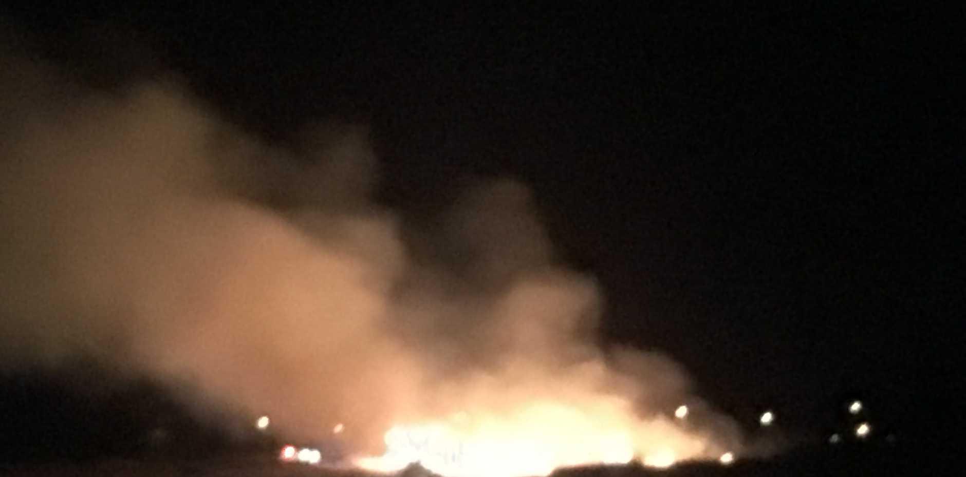 A grass fire has broken out near Taabinga School.