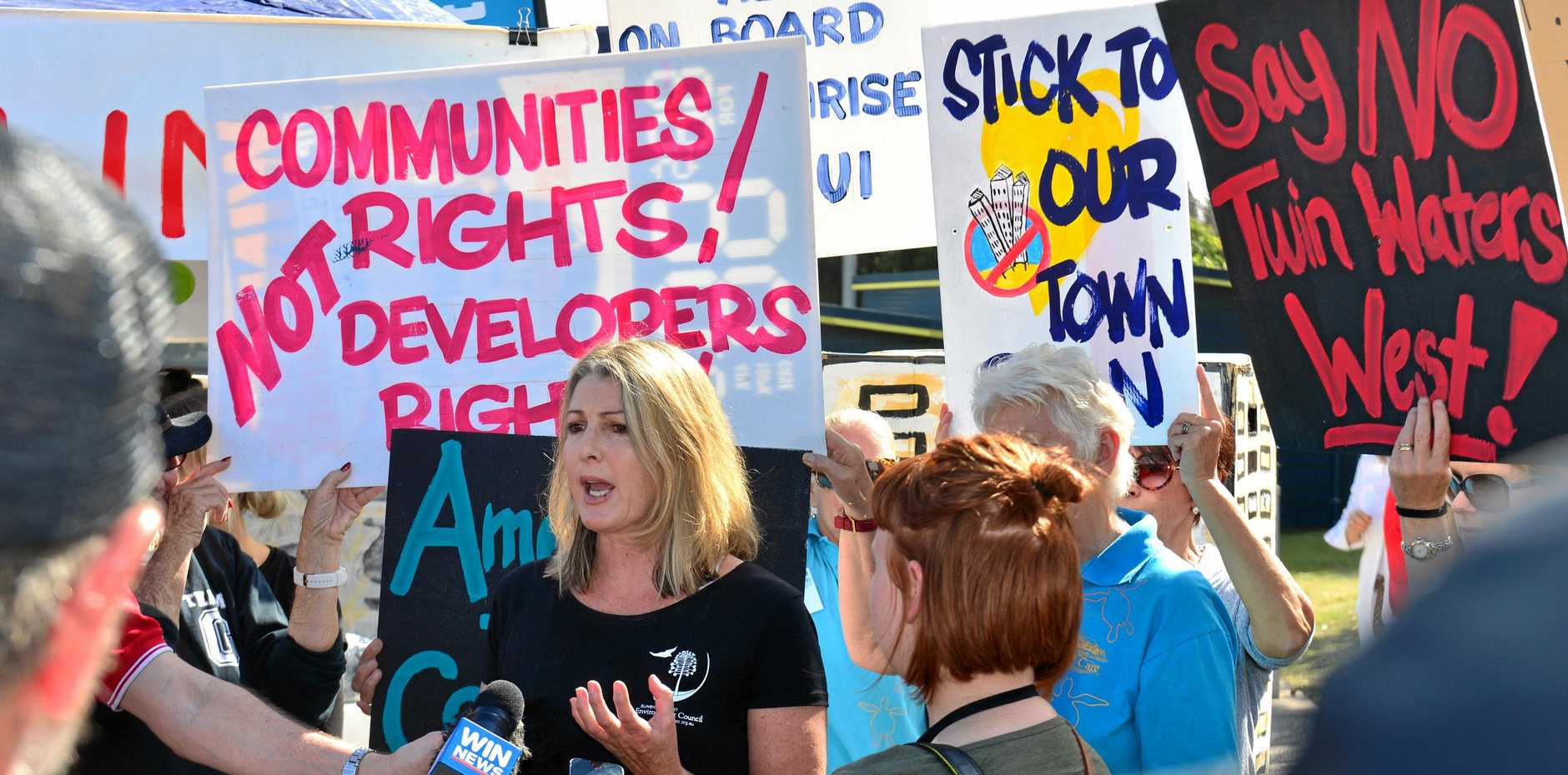 RALLY: More than 1000 people turned up to Coolum to protest the pace and scale of the Planning Scheme changes to accommodate population growth. Narelle McCarthy from the Sunshine Coast Environment Council.