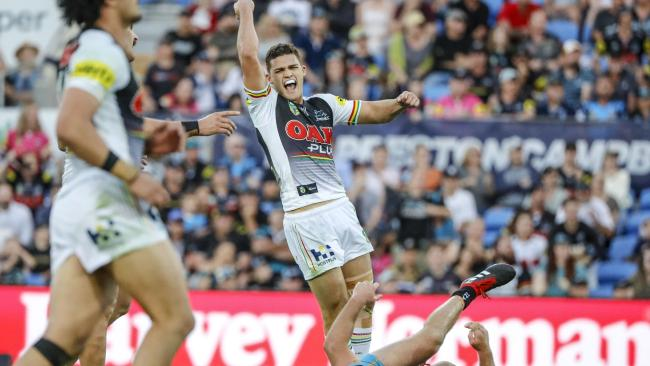 Nathan Cleary of the Panthers (centre) celebrates after kicking a golden point field goal during the Round 22 NRL match between the Gold Coast Titans and the Penrith Panthers at Cbus Super Stadium on the Gold Coast, Saturday, August 11, 2018. (AAP Image/Glenn Hunt) NO ARCHIVING, EDITORIAL USE ONLY