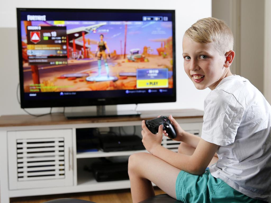 Cooper Thompson's mum Jacinta Phillips lets him play Fortnite at certain times of the day but only when his homework is finished. Picture: AAP/Josh Woning