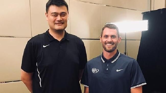 Yao Ming can make anyone look small.