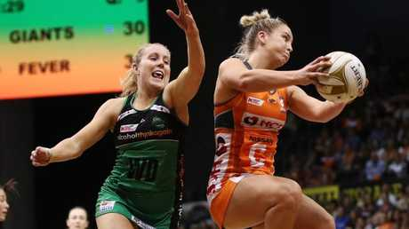 Serena Guthrie takes the ball in front of Jessica Anstiss (left). Picture: AAP