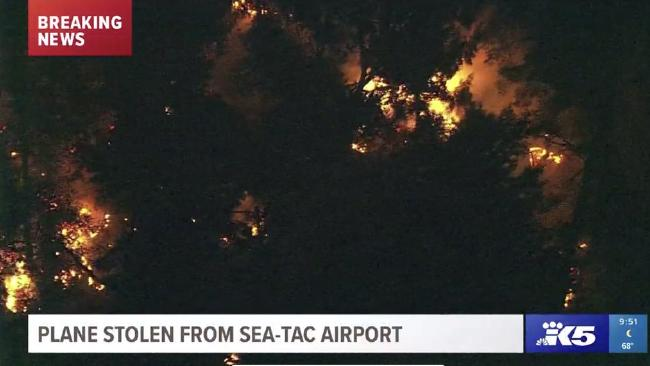 US television images of the stolen Air Q400 from Sea Taxc alight after crashing. Picture: @KING5Seattle.Source:Supplied