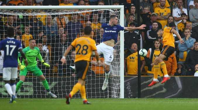 Wolverhampton Wanderers' Mexican striker Raul Jimenez (R) scores against Everton.
