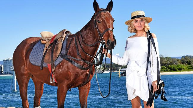 Lucky and Violet Atkinson pose for a photograph at Polo by the Sea. Polo by the Sea on the Gold Coast. Saturday June 2, 2018. (AAP image, John Gass)