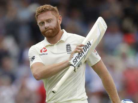 England's Jonny Bairstow holds up his bat to applause as he leaves the pitch after he was caught by India's Dinesh Karthik. Picture: AP