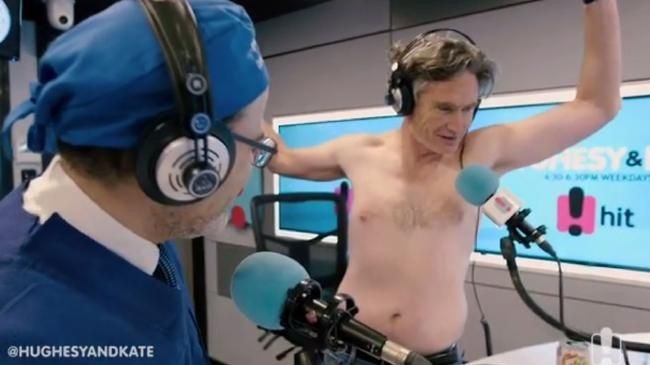 Dave Hughes getting examined by a surgeon.