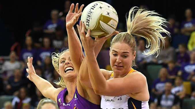 Laura Geitz (left) and Caitlin Bassett clash in a game defined by desperation. Picture: AAP