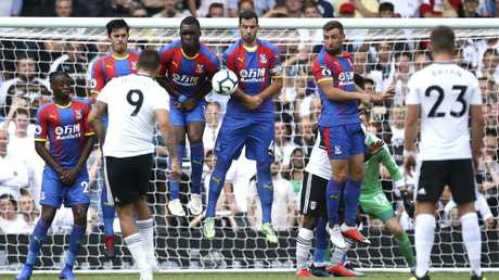 Fulham's Aleksandar Mitrovic, number 9, unsuccessfully shoots towards goal during their English Premier League soccer match against Crystal Palace at Craven Cottage in London, Saturday Aug. 11, 2018. (Yui Mok/PA via AP)