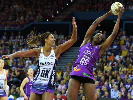 Geva Mentor puts Firebirds shooter Romelda Aiken under pressure. Picture: AAP