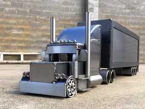 Mitch's trucking metal art takes off