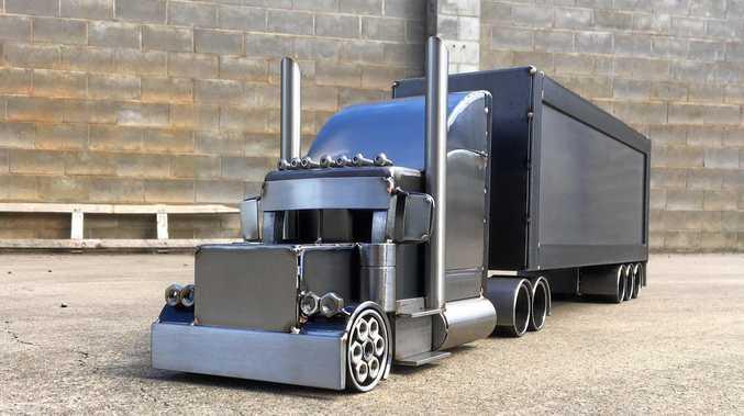 Metal artist Mitchell Agate's cool model trucks.
