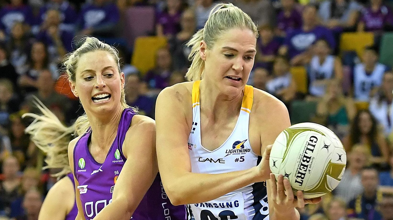 ON COURT: Laura Geitz of the Firebirds and Caitlin Bassett of the Lightning during the Super Netball Minor Semi Final match between the Queensland Firebirds and the Sunshine Coast Lightning at the Brisbane Entertainment Centre on Sunday.