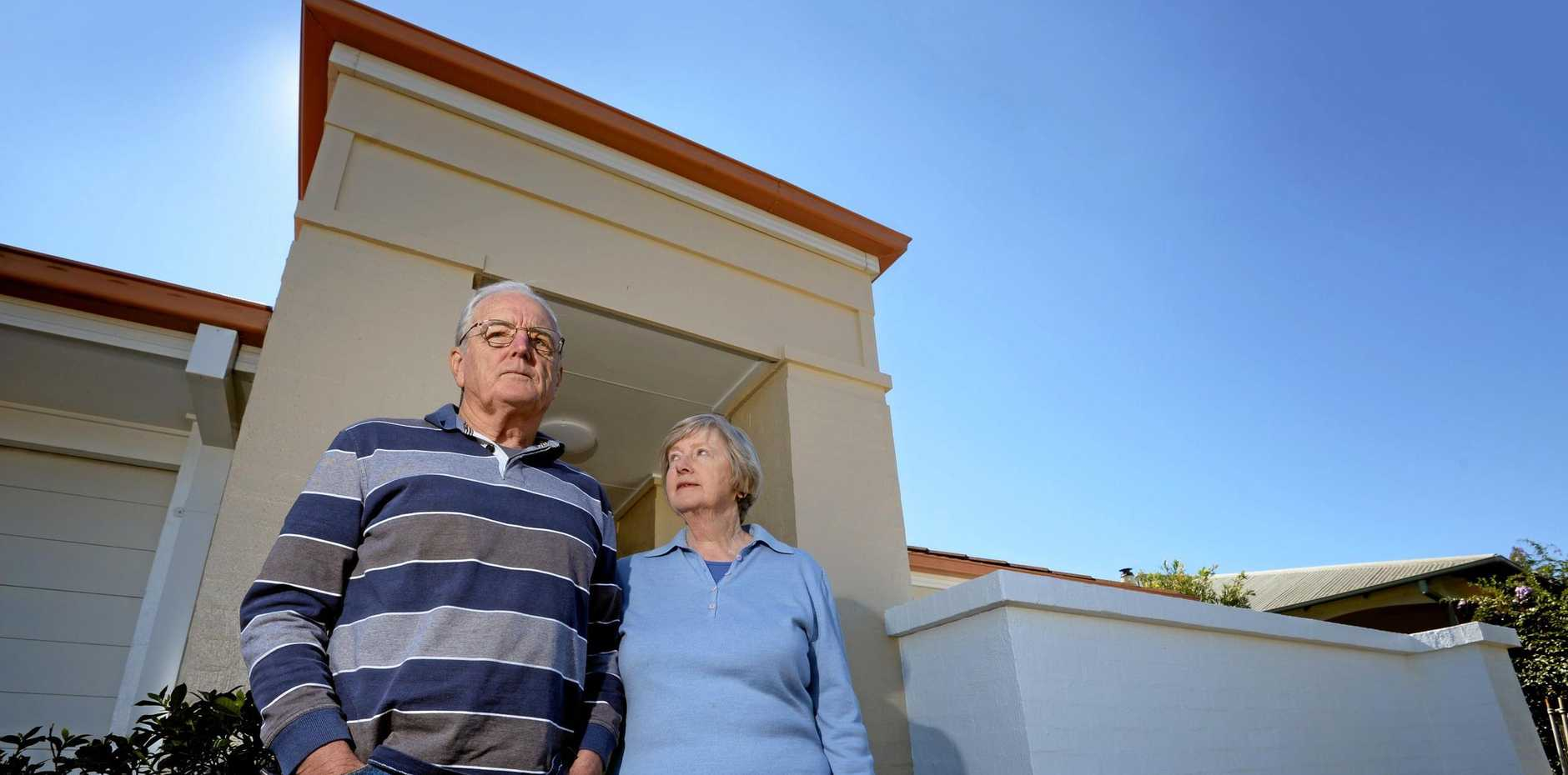 'UNFAIR': Castle Drive homeowners Chris and Robin Lowry copped abuse from protesters over the lobbing of a giant fig tree damaging their house but were more concerned by what was said to council staff: 'Whether you agree or not, they're just carrying out their job'.