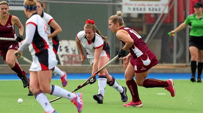 HARD FOUGHT: Mackay athlete Minka Elliott playing for the Queensland side at the Australian Country Championships.