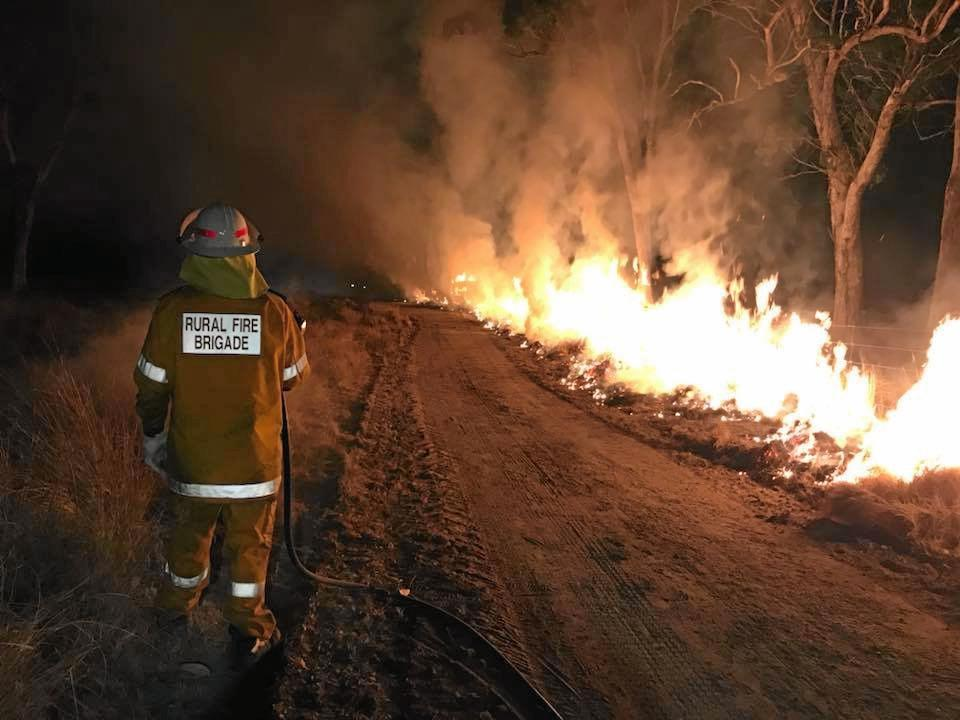 BURNING: Sixteen crews from the rural and urban fire brigades worked into Sunday night and throughout Monday morning to keep Ballandean residents safe from the bush fire.
