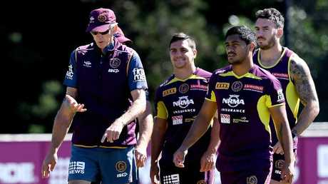 Coach Wayne Bennett talks to his players during the Broncos training session on Monday. Picture: Getty Images