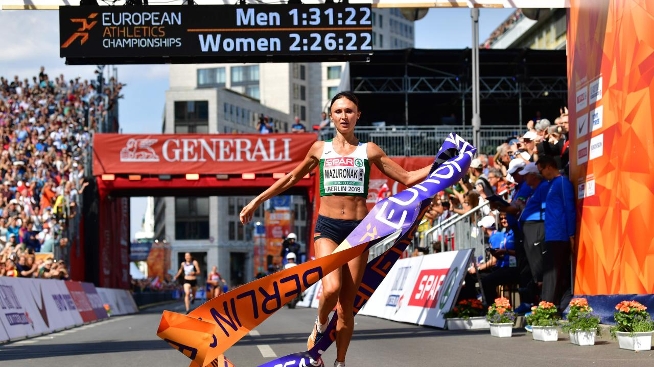 Belarus' Volha Mazuronak crosses the finish line to win the women's marathon during the European Athletics Championships in Berlin. (Photo by Andrej ISAKOVIC / AFP)
