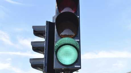Sydney traffic lights already automatically turn green for late-running buses.