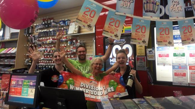 Nextra Earlville News staff Ashton Davis, Joel Philip, Annie Duff and Sara-Jane Bacon celebrate a division-one win.