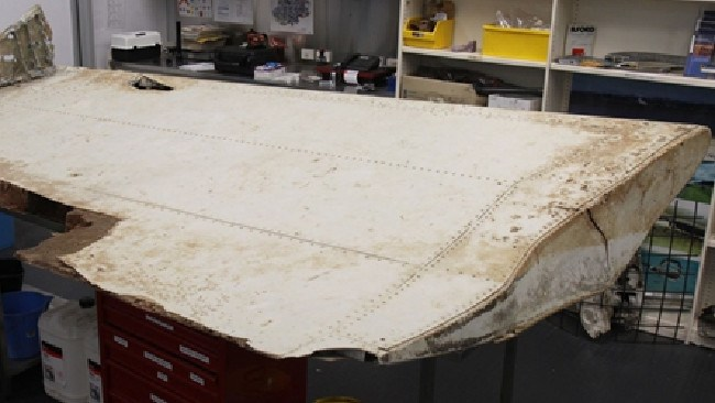 Inboard section of outboard flap from Malaysian Airlines MH370. A new theory suggests a stowaway brought the flight down. Picture: ATSB