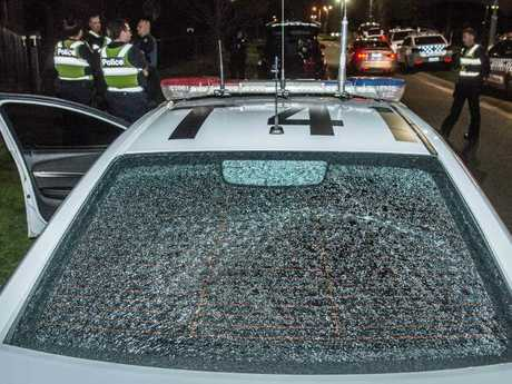 A police car was damaged by a rock thrown by a young person at Taylors Hill last week. Picture: Jason Edwards.