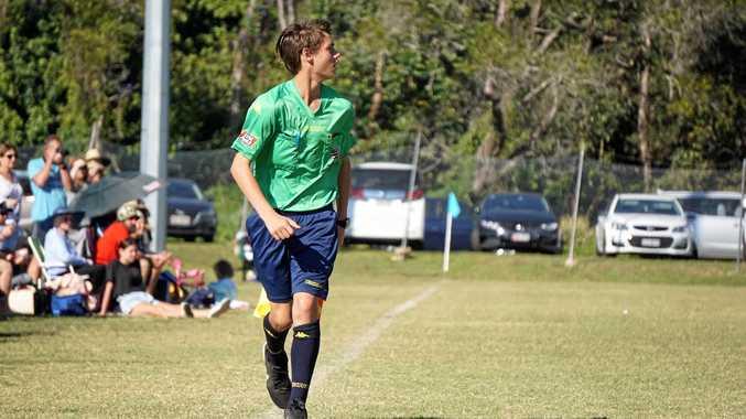 FOCUS: Blake Ashton runs the line at the 10-12 Years Football State Championships.