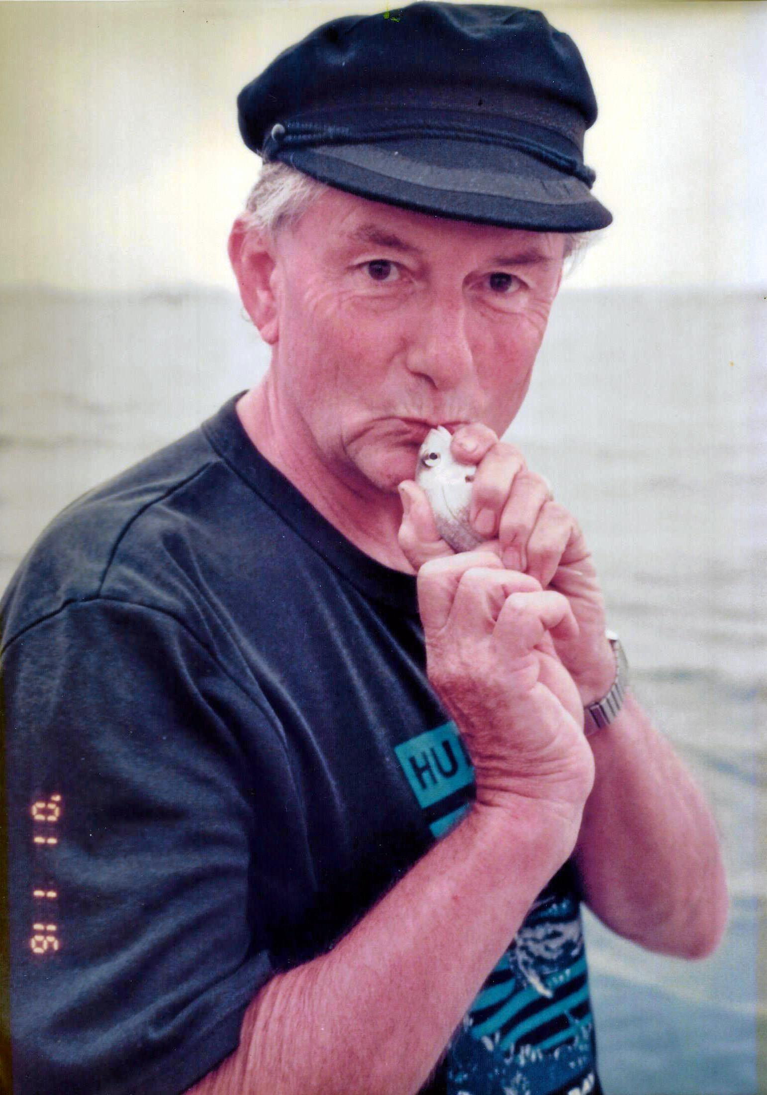 Barry giving a fish a kiss in 2001.